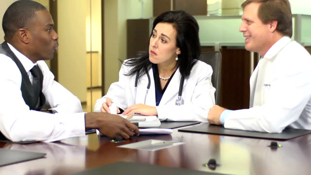 Pharmaceutical Representative Meets with Doctors - CU video