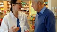 istock Pharmacist Explaining Medicine To Senior Man 657478858