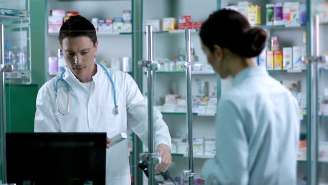 Pharmacist scanning medicines with barcode reader video