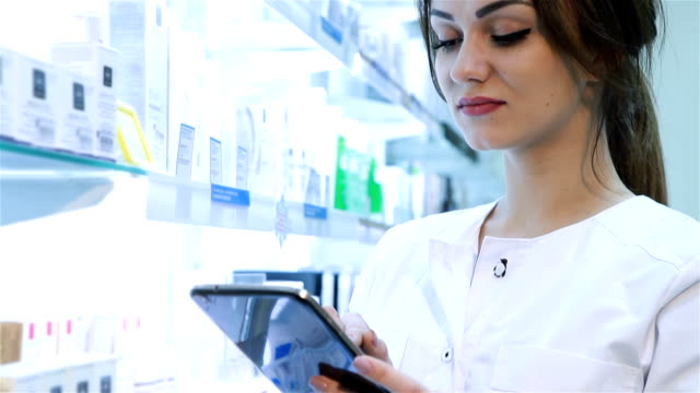 Pharmacist working with a tablet-pc video