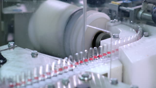 Pharmacy production line at pharmaceutical factory. Pharmaceutical industry video