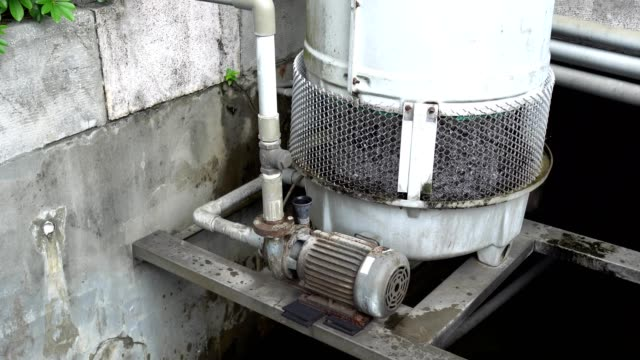 3 phase induction motor. the function is to drain or pump water. the exterior is old and rusty. over look. - imperfection stock videos & royalty-free footage