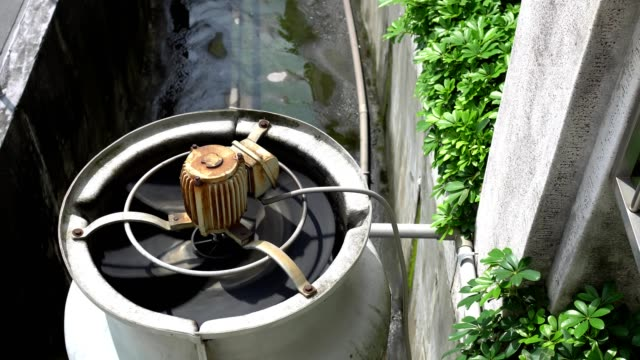 3 phase induction motor. the function is to drain or pump water. the exterior is old and rusty. - imperfection stock videos & royalty-free footage
