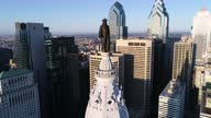 istock Philadelphia City Hall Tower and bronze statue of William Penn. Cityscape and Beautiful Sunset in Background 1313131112