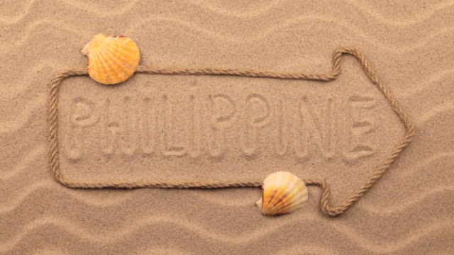 Philippine inscription written by hand on the sand, in the pointer made from rope. video