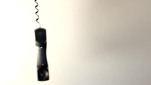 Phone hanging A telephone receiver dangling telephone receiver stock videos & royalty-free footage