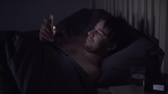 Phone message in bed, disturbed sleep. video