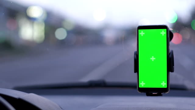 Phone on Car Dashboard Green Screen Phone on Car Dashboard Green Screen global positioning system stock videos & royalty-free footage