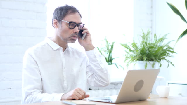 Phone Talk, Middle Aged Man Attending Call at Work video