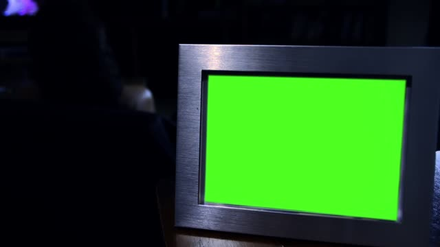 Photo Frame With Green Screen In The Dark. Zoom In. video