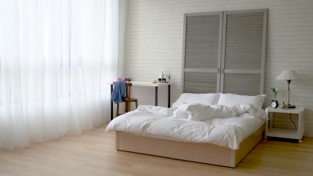 photo of a tidy and cleaned bedroom - bedroom video stock e b–roll