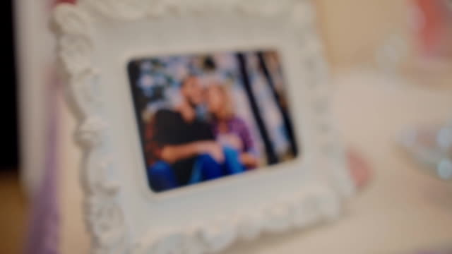 Photo of young couple in the frame Photo of young happy couple in the frame. Decoration of the table. polaroid frame stock videos & royalty-free footage