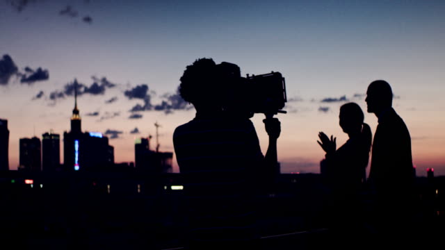 Photo session on the rooftop. Woman posing