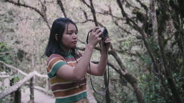 Photographer at Ang Ka Nature Trail.
