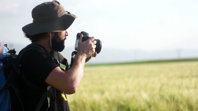 Photographer in wheat field
