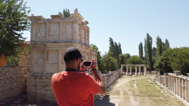 Photographer is taking photos of Aphrodisias Antique city near Artemis temple