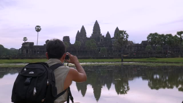 Photographer preparing for takes photographs in Angkor Wat