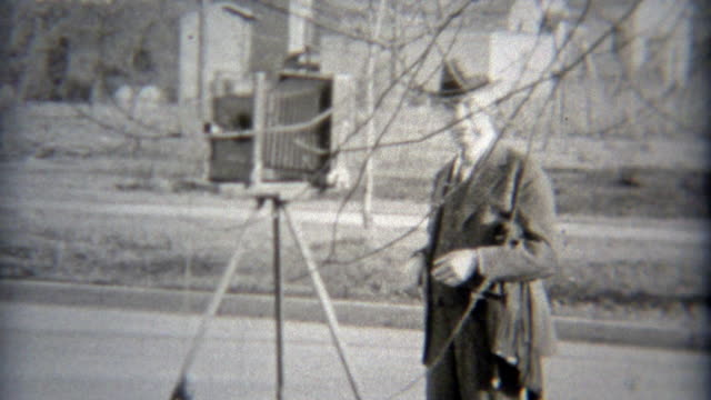 1936: Photographer setting up the shot directing people to move over. video
