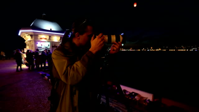 photographer shooting at night city video