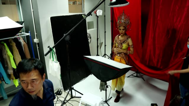 Photographer take photo of Asian Woman model with Thai Asia Traditional Costume