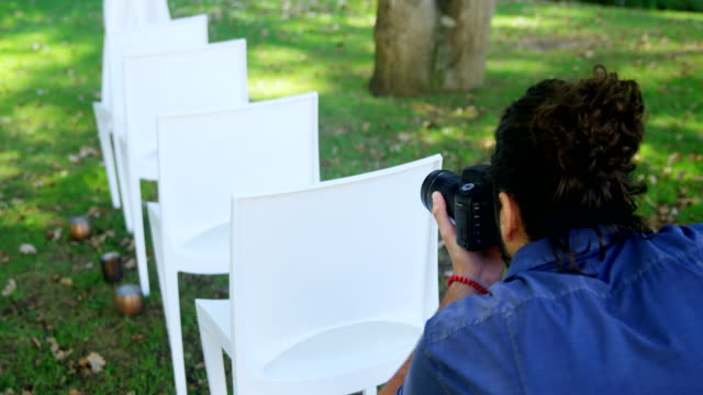 Photographer taking photo of chairs 4K 4k video