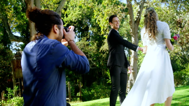 Photographer taking photo of groom and bride 4K 4k video