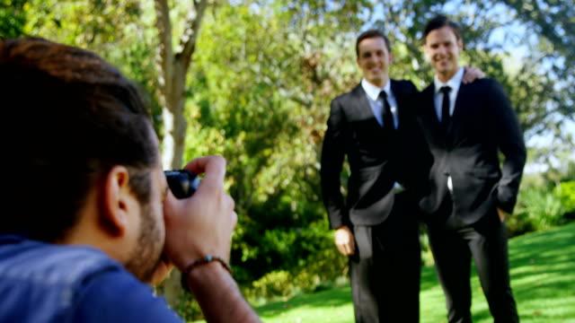 Photographer taking photo of groomsmen 4K 4k video