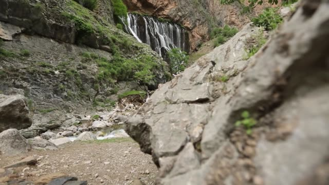 Photographer visitor/'Kapuzbasi' waterfall in the 'Aladaglar' national park.KAYSERI Kayseri/Turkey 05/27/2014