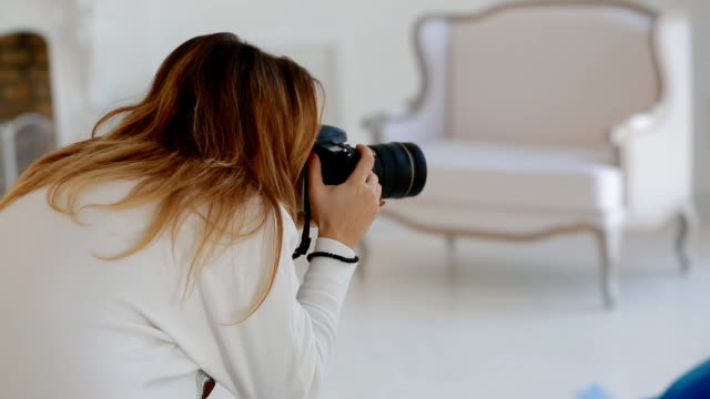 Photographer work with model in studio. Backstage Photographer work with model in studio. Backstage. Woman look at the result on the camera screen. photo shoot stock videos & royalty-free footage