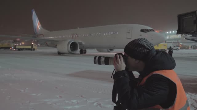 Photographer working in the airport at night