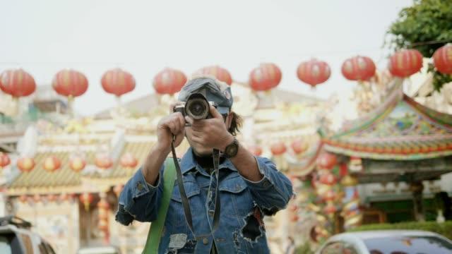 vidéos et rushes de photographe travaillant - travailleur indépendant