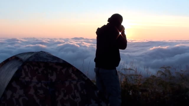 Photographers are shooting sunrise on the mountain with fog video
