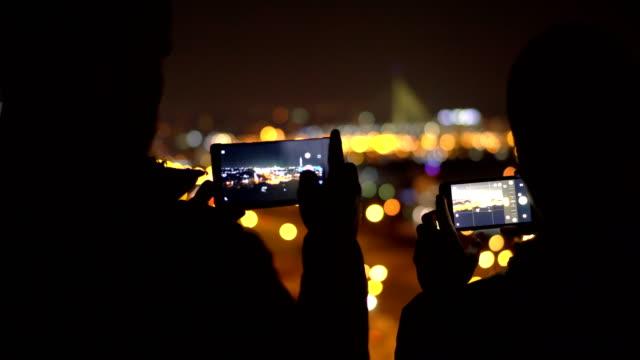 Photographing the City Photographing the City by night multimedia stock videos & royalty-free footage