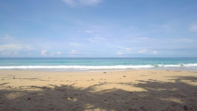 vídeos de stock e filmes b-roll de phuket, thailand. summer time beach and sea. landscape view of beach sea sand and sky in summer day. beach space area. at patong beach, phuket, thailand. 4k uhd. video clip - phuket