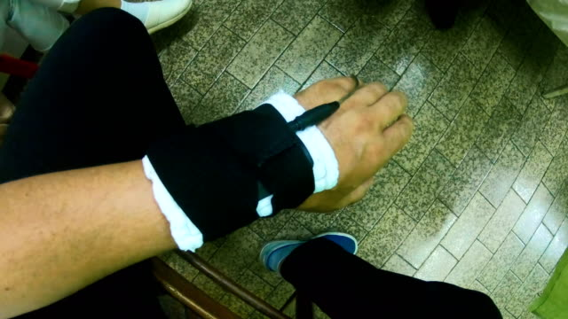 physical therapist positioning electrodes on hand for muscle treatment. tens electrodes treatment on palm - physical therapy стоковые видео и кадры b-roll