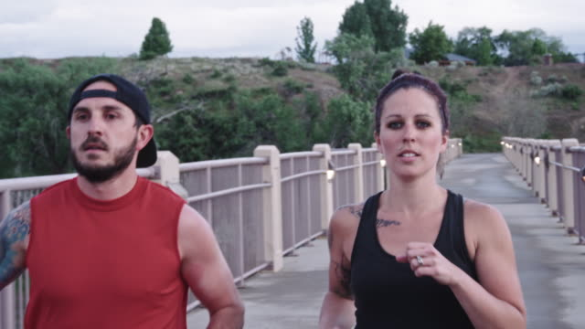 Physically Fit Caucasian Couple in their Thirties Running video