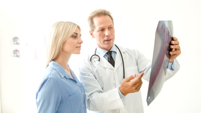 Physician discussing X-ray with his patient video