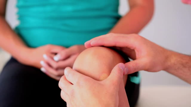 Physiotherapist checking his patients knee video
