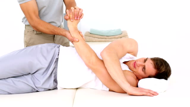 Physiotherapist moving patients injured wrist video