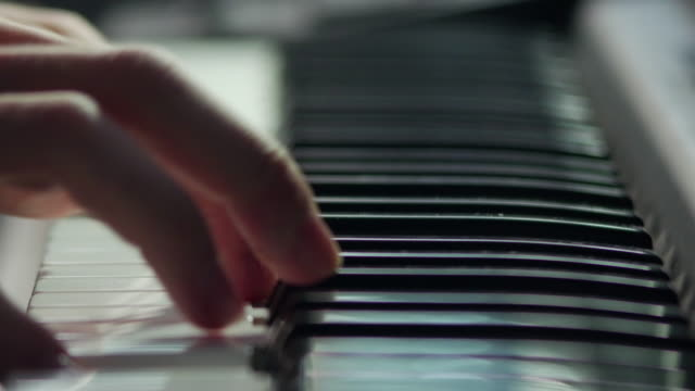 Pianist playing close up 4K UHD 2160p stock video shallow depth of field