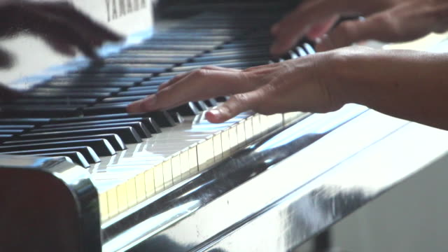 Pianist Playing Grand Piano with Cinematic Stage Lighting video