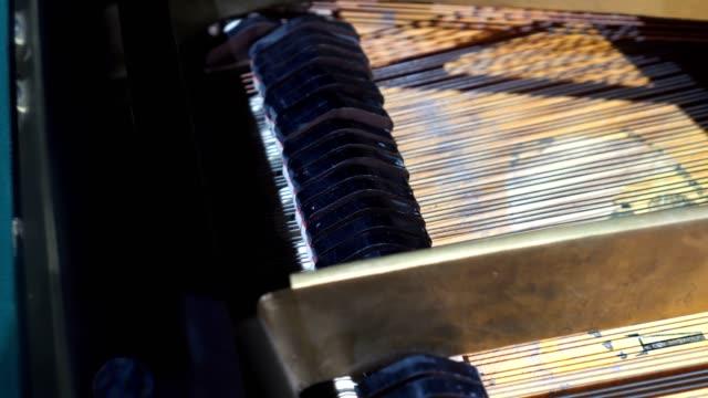 piano hammers playing keys closeup, music background - klucz ręczne narzędzie filmów i materiałów b-roll