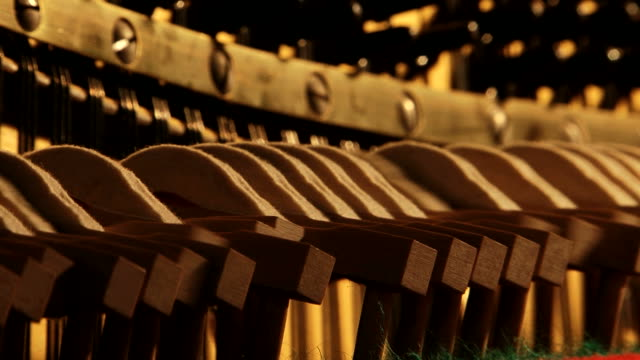 Piano mechanics inside hammers strings