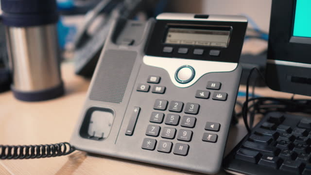 Pick up telephone press number to dial call - IP Phone Pick up telephone press number to dial call - IP Phone telephone receiver stock videos & royalty-free footage