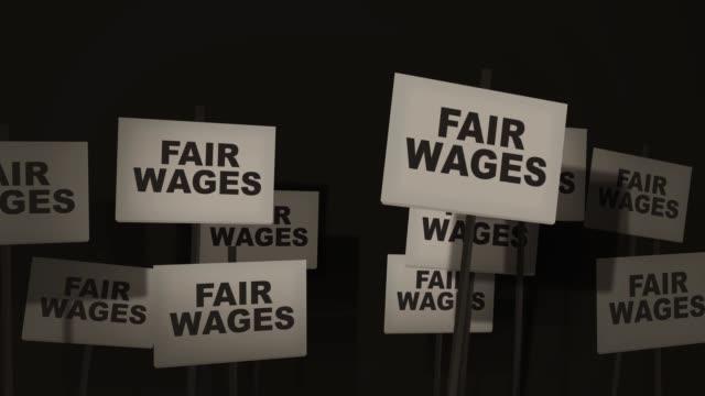 strejkvakt sign protest-serien - rättvisa löner version - lön bildbanksvideor och videomaterial från bakom kulisserna
