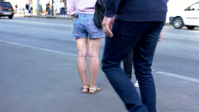 Pickpocketing male team stealing wallet from female shorts pocket, dexterity Pickpocketing male team stealing wallet from female shorts pocket, dexterity short length stock videos & royalty-free footage
