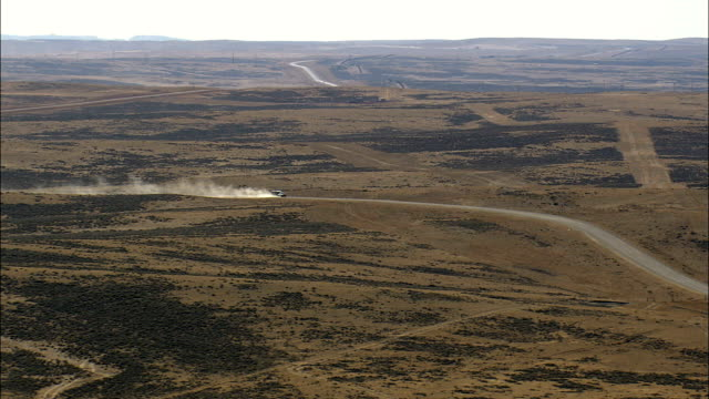 Pickup And Trailer On Dirt Road  - Aerial View - Wyoming, Campbell County, United States video