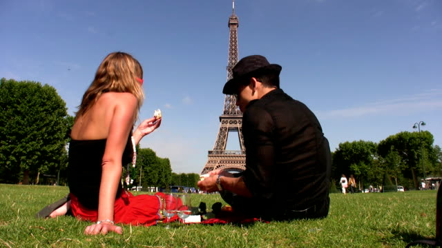 picnic in front the eiffel tower - picnic stock videos and b-roll footage