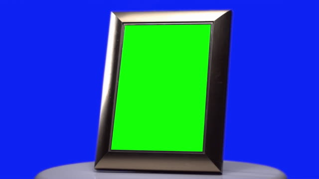 Picture frame Green screen slowly turning with Blue screen background video