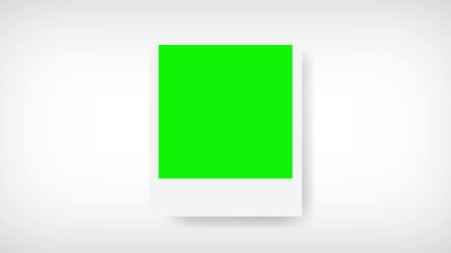 picture frame with green screen for your photo. white background - foto video stock e b–roll